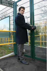 Tom Brake at the closed entrance to the new step-free path from London Road to platform two at Hackbridge