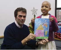 Tom Brake MP and Kareece Stone-Small with her winning Christmas card design. (Christine Hipkiss)