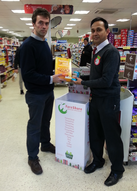 Tom Brake with Vijay, store manager at Wallington Tesco Express, during the collection