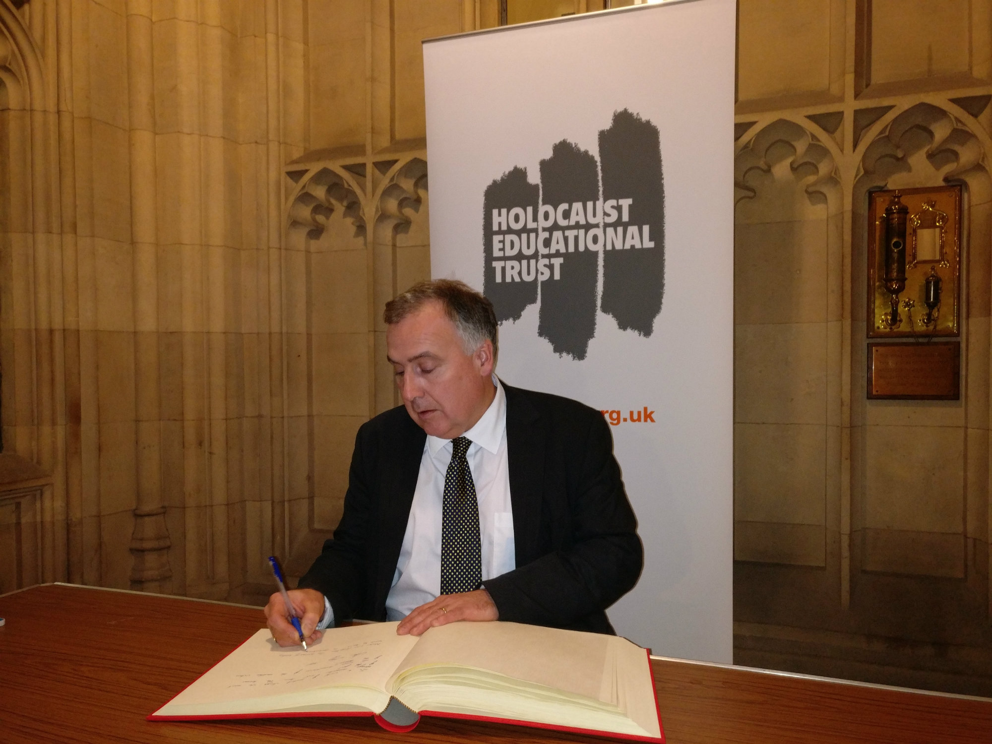 key_Mark_signs_Holocaust_Education_Trust_Book_of_Commitment_2017.jpg