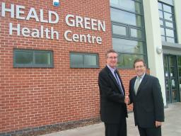 Mark alongside Heald Green Health Centre Manager Mike Nolan