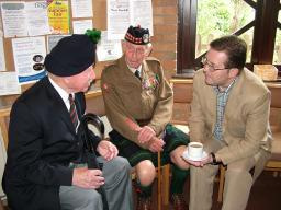 Mark with veterans Captain Robert James Robinson and First Lt Norman Harris.