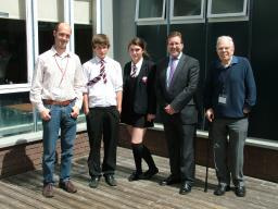 Cheadle MP Mark Hunter with representatives from Beacon and the winning group from Cheadle Hulme High School