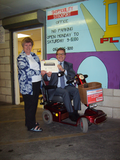 Mark alongside Janet Sutton, Chairperson of Shopmobility Stockport