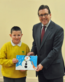 Oakgrove School pupil Austin Douglas alongside Mark presenting his winning card
