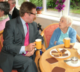 Mark alongside 100 year old Alice Williams at Guardian Lodge