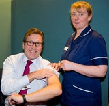 Mark getting his flu vaccination