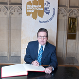 Mark signing the Holocaust Memorial Book