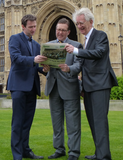 The 3 MPs reading the paper outside Parliament