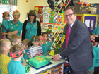 Mark Hunter MP celebrates with the staff and children at Fledgling Pre-school and Day Nursery in Bramhall