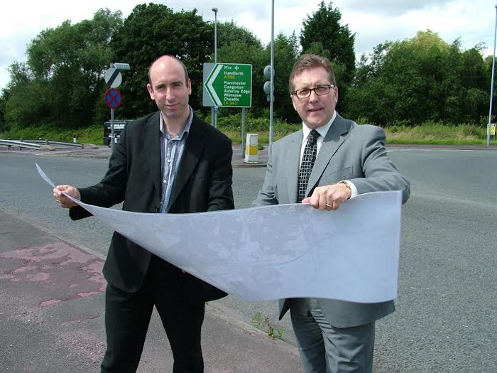 Councillor Iain Roberts and Mark Hunter MP consult plans of the A555