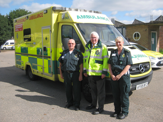 Sir Bob Russell with paramedics