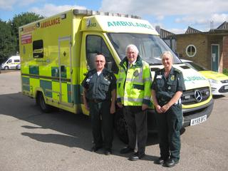 Sir Bob Russell with paramedics