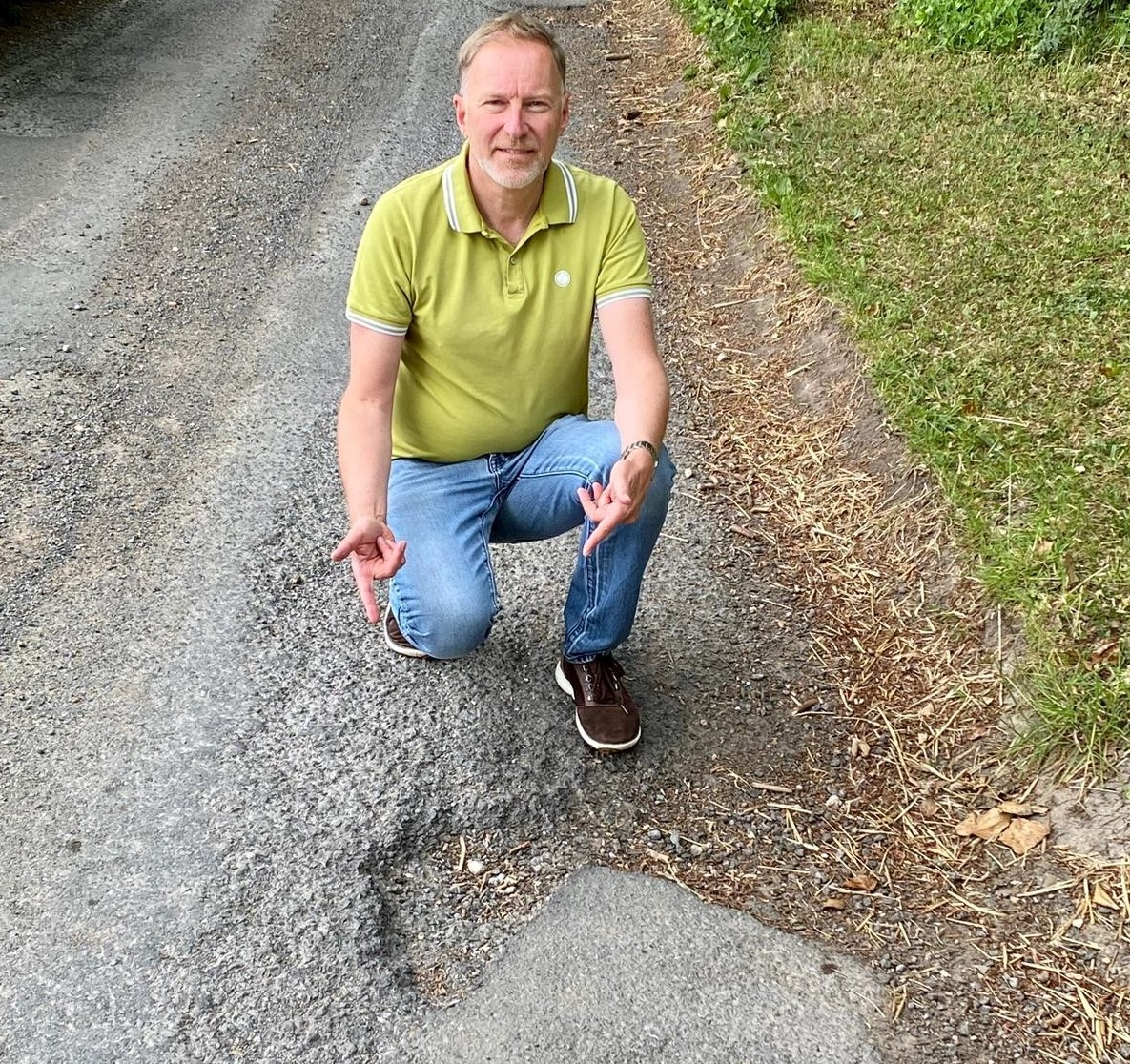 EXPOSED: COUNCIL'S FAILURE TO FIX ROADS