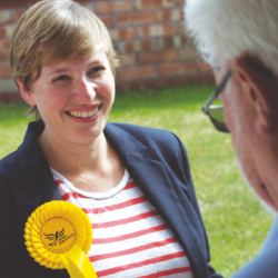 Claire Bonham, candidate, speaks to a resident