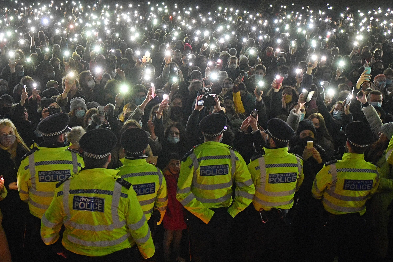 dozens of phone flashlights at a vigil at clapham common