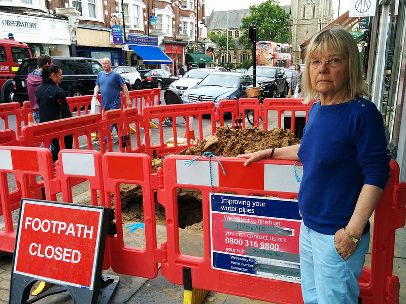 Cllr Gail Engert with a burst water main in Muswell Hill
