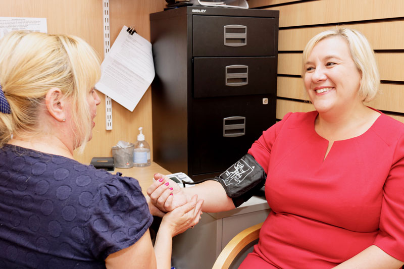Lisa Smart having blood pressure taken