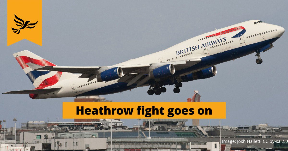A picture of an aeroplane flying: in the picture, the slogan says, 'Heathrow fight goes on'.