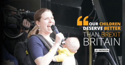Jo Swinson with baby speaking at a rally