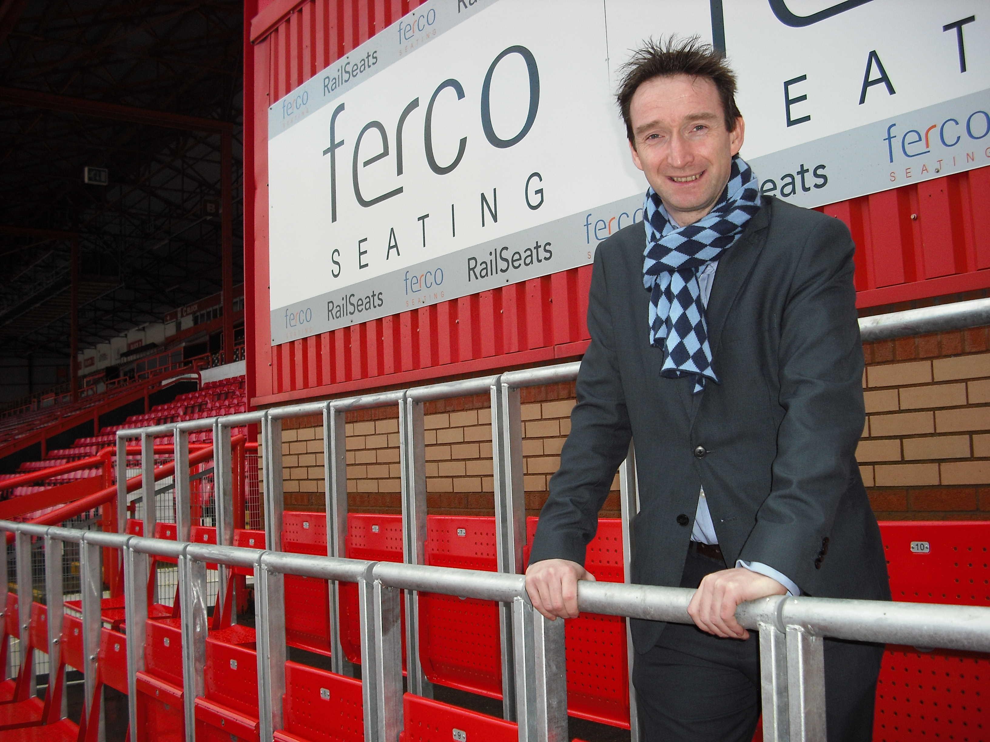John_Leech_standing_at_rail_seats_1.jpg