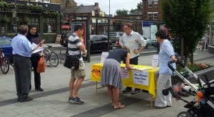 The campaign continues: collecting petition signatures and talking to residents outside Raynes Park Station on 28 June 2015.