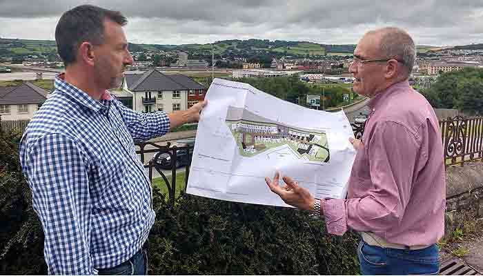 David Chandler and Alan Rennles inspect plans for the new school