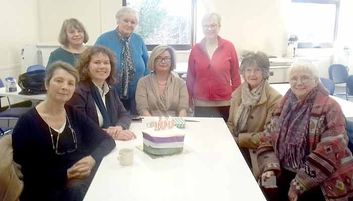 Kirsten Johnson (mid-left), with local residents and the celebration cake.