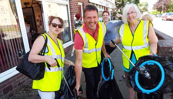 Cllrs Julie Hunt, David Chalmers and Sue Haywood collecting litter