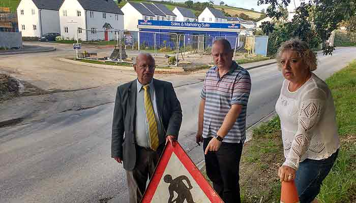 Cllrs Brian Greenslade, Ian Roome and Joy Cann inspect roadworks at Goodleigh Road