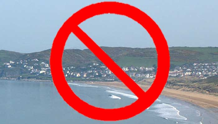 Graphic showing Woolacombe and prohibited road sign