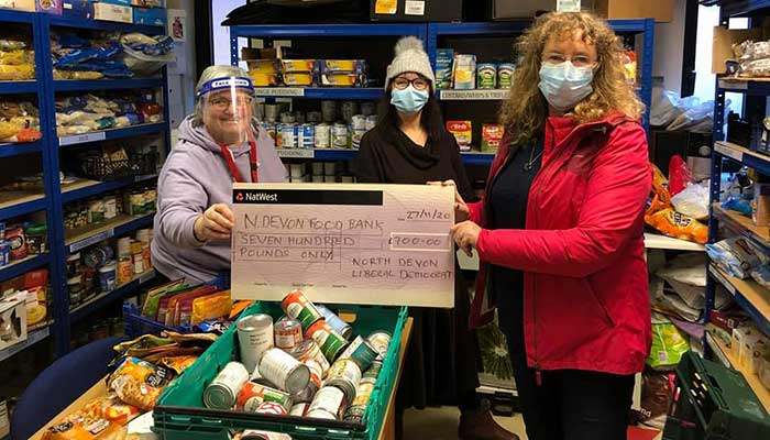 Lib Dem Cllrs Julie Hunt and Caroline Leaver donating a share to Barnstaple Food Bank.