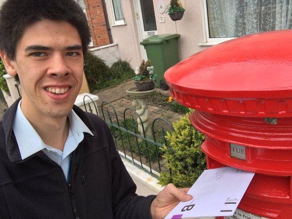 Picture of person putting postal vote in post box