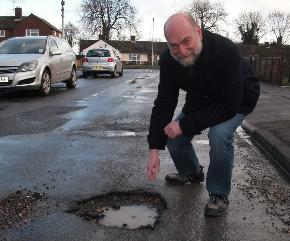 Ricky Duveen with a pothole.