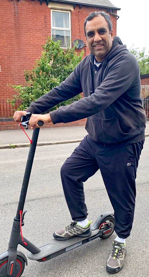 Cllr Shaffaq Mohammed on a scooter