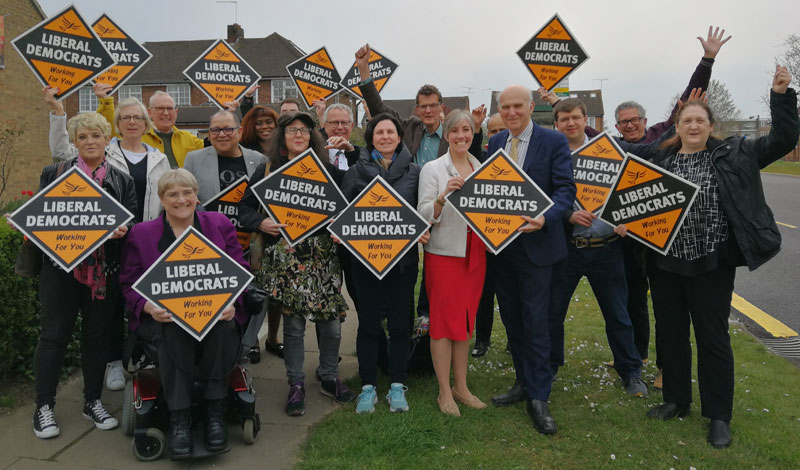 Vince Cable with party president Sal Brinton and campaigners in St Albans