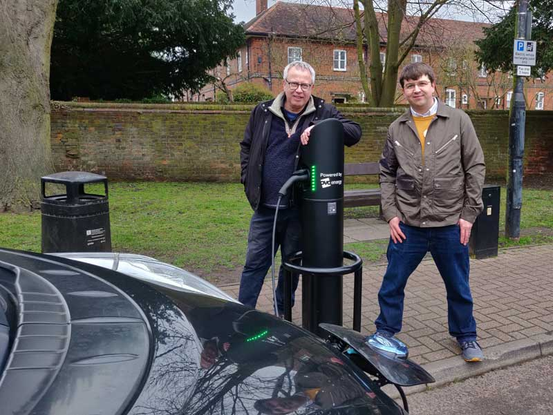 Chris White and Will Tucker at an electric charge point