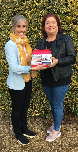 Daisy Cooper presents food vouchers to Emma Dalton