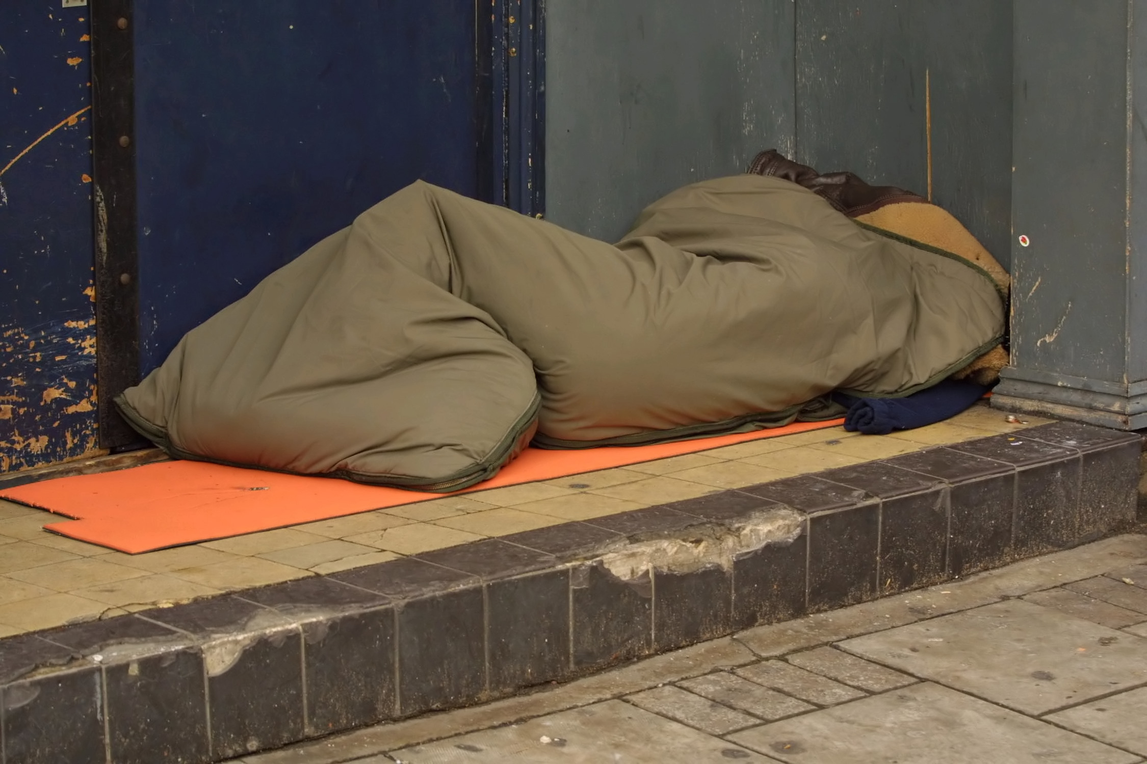 Rough sleeper in doorway