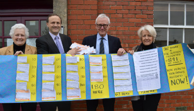 Visiting minister Norman Lamb MP is shown the large volume of petition signatures calling for action by local MP Steve Webb and councillors Shirley Holloway (L) and Maggie Tyrrell