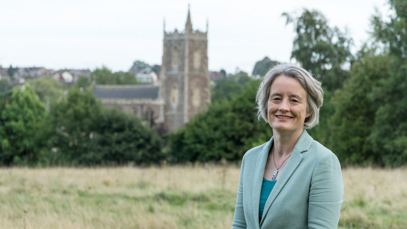 Claire Young in front of a church in Frampton Cotterell