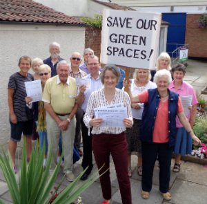 Liberal Democrats hadning in the Save Our Local green Spaces petition