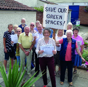 Liberal Democrats celebrate their successful cmapaign to protect vital commmunity green spaces in Thornbury and Alveston