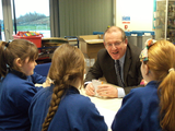 Aled Roberts AM talking with pupils