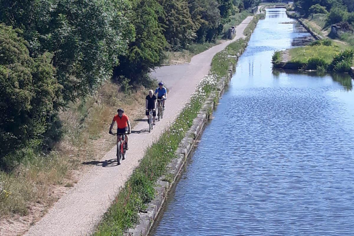 Cyclists travelling along canal towpath