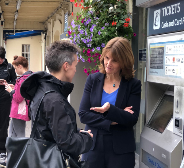 Paula Ferguson, talking to a commuter outside Winchester Rail Station
