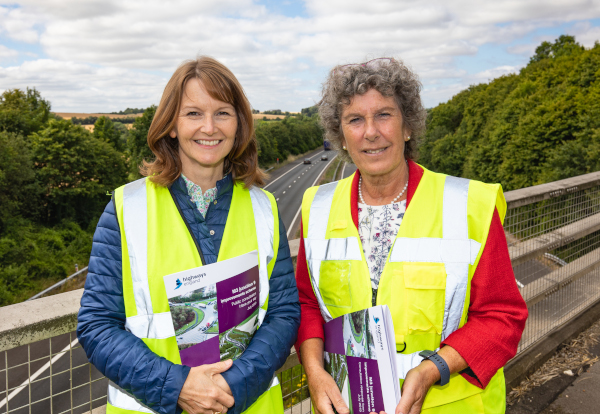 Paula Ferguson and Jackie Porter standing on an M3 motorway bridge