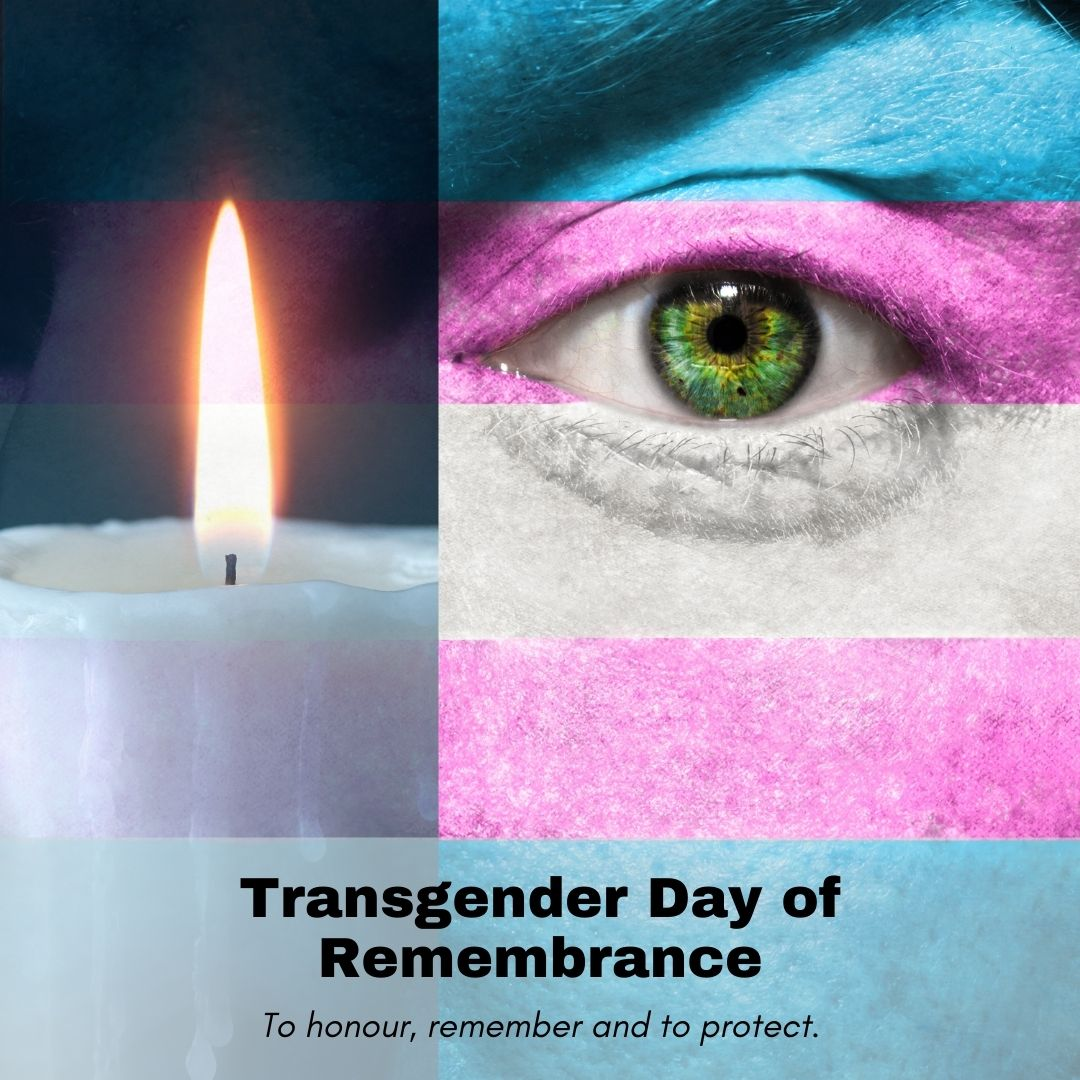 A candle, and an amazing green eye, with the transgender flag colours over the skin.