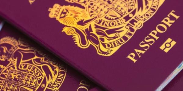 A pile of burgundy UK passports