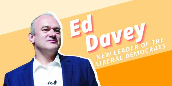 Ed Davey addresses a crowd through a megaphone